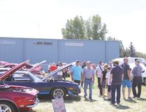 The Field of Dreams Show 'N Shine care show was held on Saturday, July 22. Here, attendees of the car show enjoy the weather and the vehicles on display.
