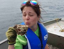 <p>Handout/Cornwall Standard-Freeholder/Postmedia Network</p><p> River Institute volunteer Jennifer Lounsberry with a discarded cup that was found in the river during an underwater cleanup on Sunday, July 23, 2017.