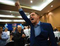 Wildrose leader Brian Jean celebrates the yes vote following the party's vote on uniting with the Progressive Conservatives, in Red Deer Saturday July 22, 2017. Photo by David Bloom/ Postmedia Network