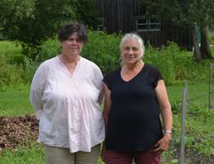 Kathy Sturmey and Tara Kainer, two of many organizers of the Community Harvest Garden, pose in front of the Mother Garden at the Sisters of Providence of Saint Vincent De Paul in Kingston. (Ashley Rhamey/For The Whig-Standard)