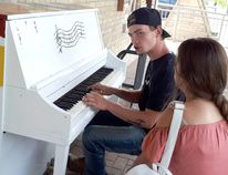 Sean Comyn, 17, of Bruce Twp. serenades his girlfrend Mikaylah Williams on the Kincardine Centre for the Arts outdoor piano next to Victoria Park. Singing his original song 'My Mistakes', he barely missed a beat when a photographer popped up to listen in and capture the moment. (Troy Patterson/Kincardine News and Lucknow Sentinel)