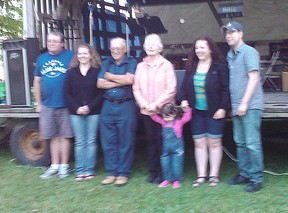 Lucy and Allan Miller and family, owners of the Holyrood General Store, presented $1,100 from their last pig roast to the Purple Grove Well Fund on July 15, 2017. The pig roast had been an annual event since 1968.