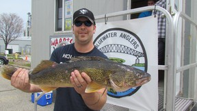 Kevin Ewart of Corunna holds a 9.6-pound walleye at last year's Bluewater Anglers Salmon Derby. The club's annual walleye derby is set for Aug. 11-12. (Observer file photo)