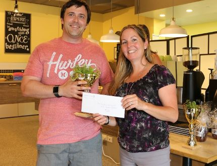 Julie Welker, community partnership specialist with the Upper Thames River Conservation Authority, presents Sean Hunter of Glen Cairn Community Resource Centre with a prize following Adelaide Business in Bloom, a friendly competition among members of the Glen Cairn neighbourhood. (Photo courtesy the Upper Thames River Conservation Authority)