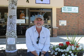 Simon Joynes, Port Stanley Festival Theatre's artistic director, sits outside the theatre on the village's main street. The theatre was the recipient of an Ontario Arts Council grant of $36,100, which was announced by MPP Jeff Yurek on Tuesday. (Laura Broadley/Times-Journal)