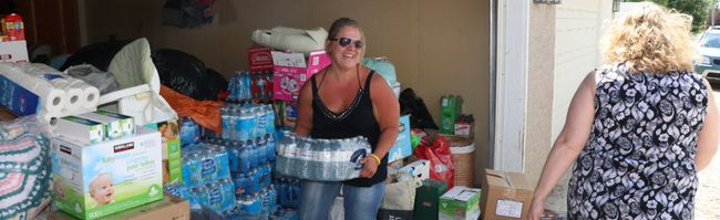 Karen Drapper , right, and Mireille Evans loads supplies for people displaced by the BC Fires