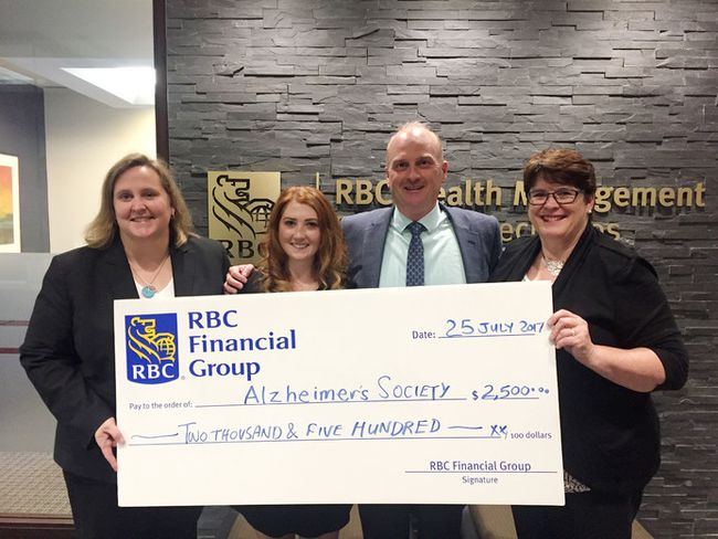 Riding to Remember's Cassandra Cahill, second from left, accepts a donation of $2,500 from RBC Financial Group. RBC King Street branch manager Jennifer Lemieux, left, and Shawn Cahill present the cheque along with Cahill and Lesley Kimble from the Alzheimer Society of KFL&A. (Joseph Cattana/For The Whig-Standard)