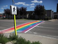 A newly-painted Pride crosswalk spans Hardin Street at the corner of Biggs Avenue in downtown Fort McMurray, Alta. on Sunday, July 23, 2017. Olivia Condon/Fort McMurray Today/Postmedia Network