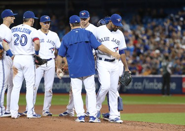 TORONTO, ON - JULY 25: Cesar Valdez #64 of the Toronto Blue Jays exits the game as he is relieved by manager John Gibbons #5 in the seventh inning during MLB game action against the Oakland Athletics at Rogers Centre on July 25, 2017 in Toronto, Canada. (Photo by Tom Szczerbowski/Getty Images)