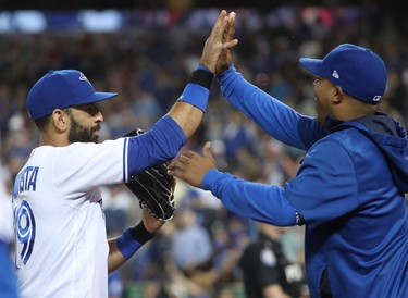 TORONTO, ON - JULY 25: Jose Bautista #19 of the Toronto Blue Jays is congratulated by Marcus Stroman #6 after making a running catch in the seventh inning during MLB game action against the Oakland Athletics at Rogers Centre on July 25, 2017 in Toronto, Canada. (Photo by Tom Szczerbowski/Getty Images)