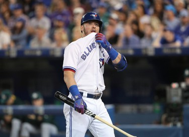 TORONTO, ON - JULY 25: Josh Donaldson #20 of the Toronto Blue Jays reacts after being called out on strikes following a long at-bat in the seventh inning during MLB game action against the Oakland Athletics at Rogers Centre on July 25, 2017 in Toronto, Canada. (Photo by Tom Szczerbowski/Getty Images)