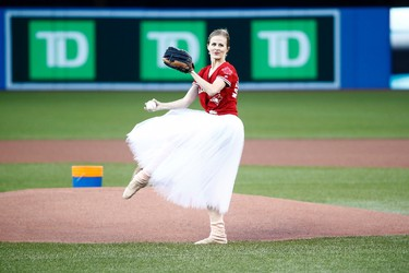 Heather Ogden, Principal Dancer at the National Ballet of Canada, throws out the ceremonial first pitch ahead of American League MLB baseball action between the Toronto Blue Jays and the Oakland Athletics in Toronto on Tuesday, July 25, 2017. THE CANADIAN PRESS/Mark Blinch ORG XMIT: MDB501