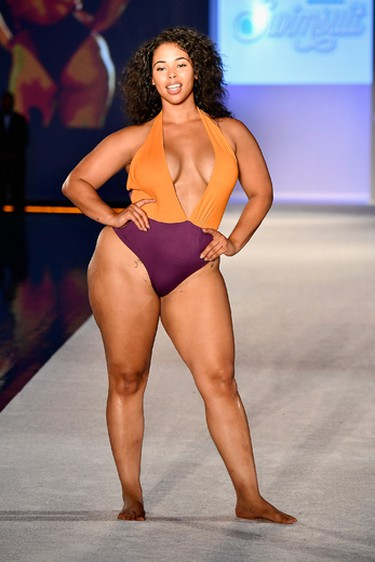 A model walks the runway during Sports Illustrated and Wall present SWIMMIAMI 2017 Opening Party Runway and Performance at WET Deck at W South Beach on July 20, 2017 in Miami Beach, Florida.  (Photo by Frazer Harrison/Getty Images for SWIMMIAMI)