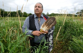 Newly elected Chippewas of the Thames First Nation Chief Myeengun Henry beside the Thames River near Plover Mills Drive, where energy company Enbridge's Line 9 runs on Monday July 24, 2017. (MORRIS LAMONT, The London Free Press)