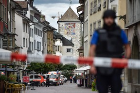 Police and ambulance cars are seen in the old quarter of Schaffhausen, northern Switzerland on July 24, 2017, after a man armed with a chainsaw injured at least five people in an attack. MICHAEL BUHOLZER/AFP/Getty Images