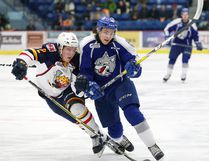 Tyler Tucker, left, of the Barrie Colts, and Ryan Valentini, of the Sudbury Wolves, chase after the puck during OHL action at Sudbury Community Arena in Sudbury, Ont. on Friday March 10, 2017. John Lappa/Sudbury Star/Postmedia Network