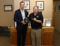 """Banff-Airdrie MP Blake Richards, left, receives the military rank insignia of Mike Watkins' father at the office of Blake Richards in Airdrie on Friday, July 21, 2017. Watkins father, Chief Warrant Officer H.C. """"Shorty"""" Watkins, served in the Canadian military for more than 40 years. The gift of the insignia by Watkins was in honour of the respect his father held for Richards."""