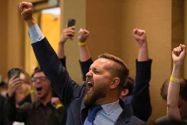 Wildrose MLA Derek Fildebrandt reacts as it is announced that the wild rose party has voted to unite with the Progressive Conservatives, in Red Deer Saturday July 22, 2017.