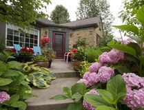 Immaculate gardens like this one at 481 Victoria St. in London invite photographers, not insects. (MIKE HENSEN, The London Free Press)