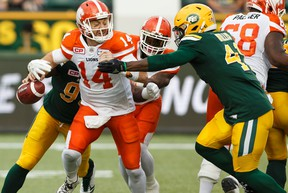 Edmonton's Kwaku Boateng (93) and Odell Willis (41) sack BC quarterback Travis Lulay during a CFL game between the Edmonton Eskimos and the BC Lions at Commonwealth Stadium in Edmonton on Friday, July 28, 2017.