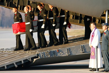 Pallbearers carry the casket of fallen Master Cpl. Byron Garth Greff out of a CC-17 Globemaster, during a repatriation ceremony held at 8 Wing/CFB Trenton, Ont. on Tuesday, Nov. 1, 2011. - JEROME LESSARD/THE INTELLIGENCER