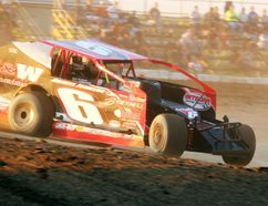 St. Catharines 358 Modified racer Mat Williamson, No. 6, competes in a qualifying heat after winning the opening race of a double feature at Merrittville Speedway Saturday night in Thorold. BERND FRANKE/Postmedia News