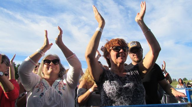 Becky McFadden, left, of Bright's Grove, and Robyn Connolly of Oakville, were in the front row Friday July 28, 2017 for the opening night of Bluewater Borderfest in Centennial Park in Sarnia, Ont. The two-nights of country music concert continues Saturday.