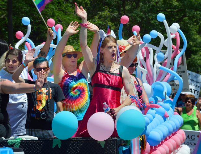 Members of the transgender community on a float in the annual London Pride parade on Queens Avenue in London, Ontario on Sunday July 30, 2017. (MORRIS LAMONT, The London Free Press)