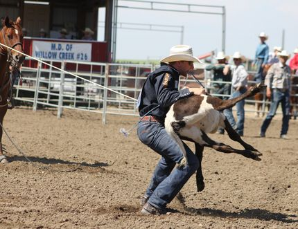 Here, Lochlan Christianson takes his calf down during day two of the rodeo.