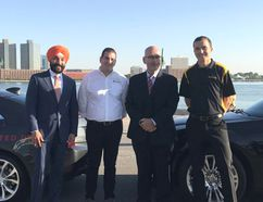 Minister of Innovation, Science and Economic Development Navdeep Bains and Minister of Transportation Steven Del Duca stand with representatives from Ontario's Magna International and Michigan's Continental Automotive North America. The two companies provided driverless cars on Monday that drove from Michigan and into Ontario, returning via Sarnia's Blue Water Bridge to Michigan. (Handout)