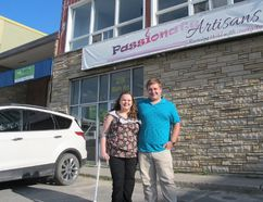 Amanda Stolk and Michael Amesse stand in the parking lot of Passionate Artisans at 28 Bath Rd., where they will hold a medical supply drive in August for their Kingston Indigenous Medical Aid Initiative. (Ashley Rhamey/For The Whig-Standard)