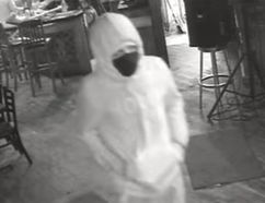 A man is seen on surveillance video at the Libertarian Public House just before he opened fire on the back patio on Monday, July 31, 2017.