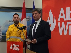 Agriculture and Forestry Minister Oneil Carlier announces a ban on off-highway vehicle use in public forests in southern Alberta on Tuesday, Aug. 1, 2017.