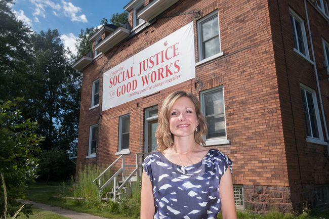 Christina Coutu Executive Director of the Centre for Social Justice and Good Works stands beside the centre in the former convent on Herrick Street. The agency works with a close relationship to Precious Blood parishioners and The Islamic Association of Sault Ste. Marie. Ali Pearson/Sault This Week