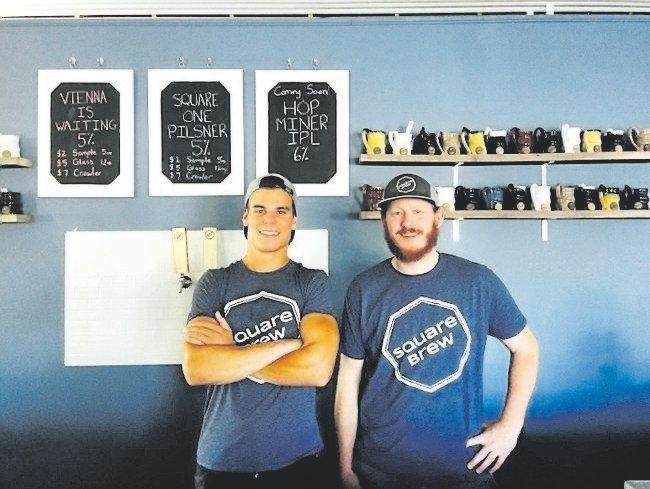 "Square Brew's Alex Menary, right, and Connor Brown opened their Goderich brewery in June. Their beer is available in one-litre cans called ""crowlers."" (Special to Postmedia News)"