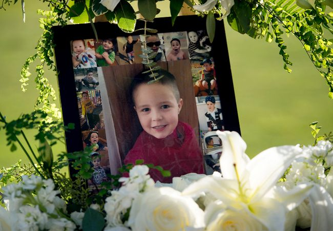 This July 19, 2017 file photo shows a portrait of five-year-old Aramazd Andressian Jr. at a memorial in his memory at the Los Angeles County Arboretum in Arcadia, Calif. Aramazd Andressian Sr. has pleaded guilty to killing his 5-year-old son. Andressian Sr. entered the plea to first-degree murder Tuesday, Aug. 1, 2017 in Los Angeles County Superior Court in Alhambra, Calif. He previously pleaded not guilty to a murder charge and was being held on $10 million bail. (Leo Jarzomb /Los Angeles Daily News via AP, file)