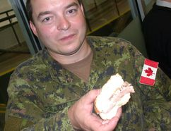 Paul Svoboda/The Intelligencer Corporal Rene Valliere of 8 Wing Trenton samples beer-braised beef brisket on an onion bun during a Belleville Senators press conference Wednesday at the Quinte Sports and Wellness Centre. B-Sens announced a partnership with Spectra for food, beverage and hospitality operations at AHL home games next season at Yardmen Arena.