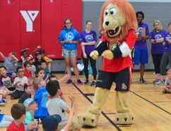 Ottawa Senators mascot Spartacat was at the YMCA of Kingston on Wright Crescent to meet with 100 campers. After giving away sunglasses and backpacks from the NHL team, Spartacat presented the YMCA with a $10,000 cheque to the YMCA administration. (Joseph Cattana/For The Whig-Standard)