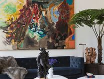 """This New York living room designed by Drake/Anderson shows large scale art playing a starring role. """"An interior never looks finished without art,"""" says Caleb Anderson. """"Its use in a room adds dynamism more than any other element."""""""