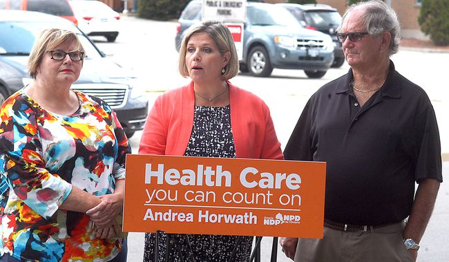 Ontario NDP leader Andrea Horwath speaks at a press conference in Wallaceburg, Ont. on Thursday, August 3, 2017, to talk about Sydenham District Hospital's funding designation. She is flanked by Wallaceburg-Walpole Island First Nation Health Coalition chair Shirley Roebuck and Save Our Sydenham chair Conrad Noel. (DAVID GOUGH, Postmedia News)