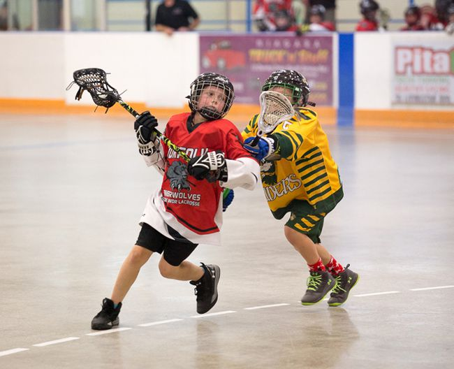 Ryan Hale of the Norfolk Timberwolves tries to avoid a Welland defender during the Ontario Lacrosse Association Zone 9 final. The novice and midget Timberwolves captured their respective Zone 9 banners in advance of the Ontario Lacrosse Festival beginning later this week.  Darryl Van Gaal/Contributed photo