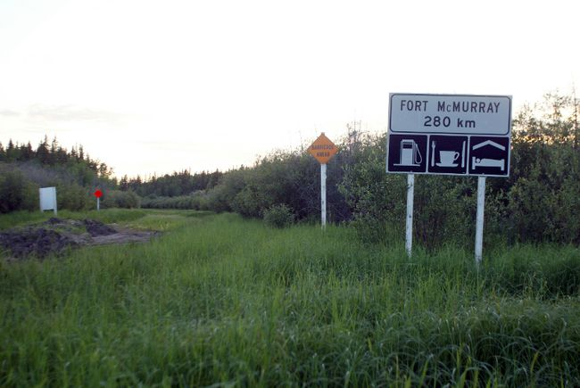 Fort Chipewyan- June 29/05 - A sign showing the distance to Fort McMurray at the start of the now overgrown Fort Chipewyan winter road. Photo:Rick MacWilliam/Edmonton Journal