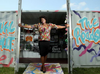 Yamikani Msosa, public education co-ordinator for the Sexual Assault Support Centre of Ottawa, stands outside the Sexual Assault Road Show shipping container on Montreal Road Thursday . The road show will run through August and features an art exhibit, workshops and is a resource hub for victims and families. JULIE OLIVER / POSTMEDIA