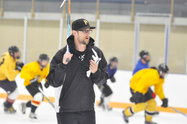 Keeping watch of those trying out for the Mitchell Jr. C Hawks during their opening night of training camp Aug. 1 was new head coach Joel Riley. Camp continues this week, Aug. 9 and 11. ANDY BADER/MITCHELL ADVOCATE