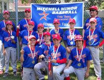 Members of the Mitchell Pee Wee OBA baseball team celebrate their tournament victory in Chatham July 30. SUBMITTED