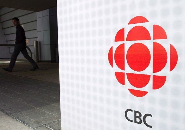 A man leaves the CBC building in Toronto on Wednesday, April 4, 2012. THE CANADIAN PRESS/Nathan Denette