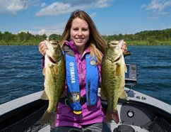 Columnist Ashley Rae with some largemouth bass caught and released on Loughborough Lake. (Ashley Rae/Postmedia Network)