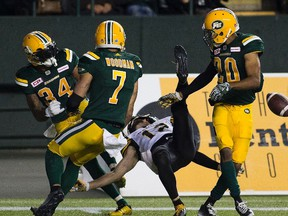 Edmonton Eskimos Garry Peters (34) Josh Woodman (7) and Johnny Adams (20) stop a final attempt by the Hamilton Tiger-Cats Mike Jones (12) to win the game on Friday August 4, 2017, in Edmonton.