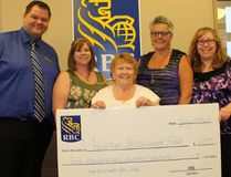 Joanne Lancaster (centre), Wiarton skateboard committee chair, received $1,600 from the Royal Bank of Canada Wiarton branch towards the Wiarton skateboard park build at the bank in Wiarton, July 25. Photo by Zoe Kessler/Wiarton Echo