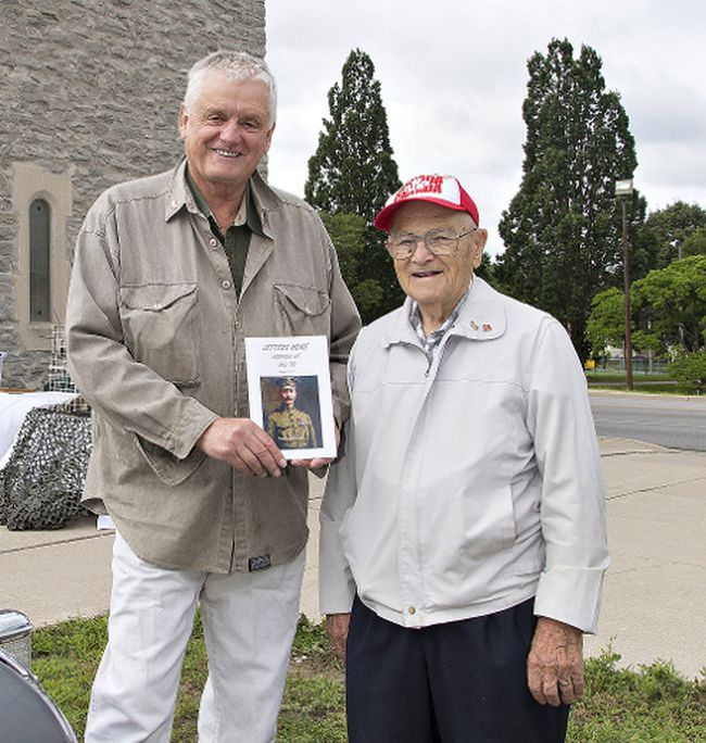 Second World War veteran Art Hayward of Simcoe, right, stands with Haldimand-Norfolk MPP Toby Barrett, who was the first to purchase a copy of Letters Home Norfolk at Hill 70, during the booklet's launch on Saturday in Simcoe. Brian Thompson/Postmedia Network